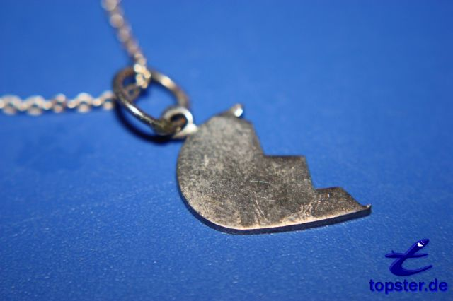 Necklace with half a heart